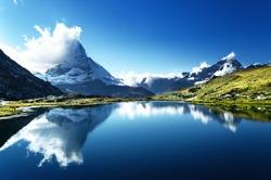 Reflection of Matterhorn in lake Riffelsee, Zermatt, Switzerland