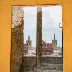 Reflection of old town Valencia in the glass construction inside Torres de Quart (ancient western city gate of old town Valencia).
