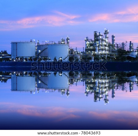 Reflection of petrochemical industry on sunset colorful sky