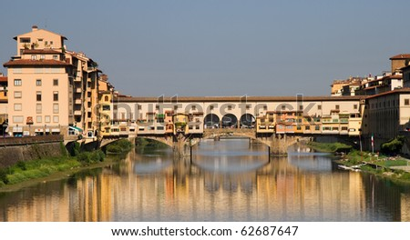 Reflection of Ponte Vecchio at the river Arno, Florence, Italy