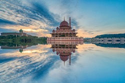 Reflection of Putra Mosque during sunrise from a lake. Soft focus due to long exposure technique