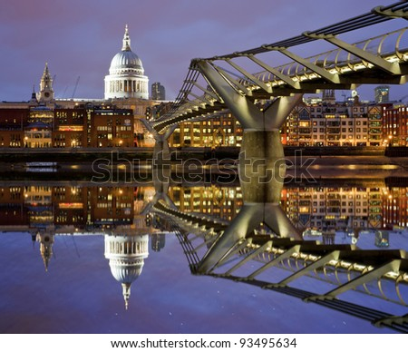 Reflection of St Paul's Cathedral and the Millenium footbridge from the River Thames, London