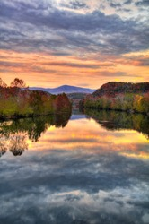 Reflection of sunset in the river running through the Blue Ridge Mountains