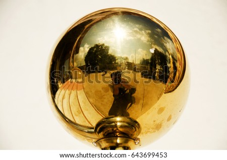 Reflection of thai man photographer shooting photo on gold sphere ball in temple of thailand #643699453