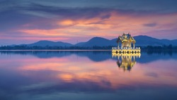 Reflection of thai pavilion at Khao Tao reservoir in sunset, Hua Hin, Thailand