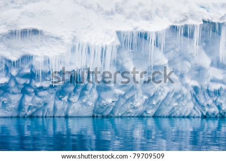 Reflection of the Antarctic Glacier with icicles