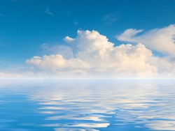 reflection of the cloudy sky in the calm water surface of the sea