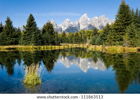 Reflection of the Grand Tetons Near Jackson Hole, Wyoming in Grand Teton NP, USA.