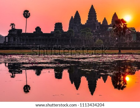 Reflection of the main temple in the lake at sunrise, Angkor Wat, Cambodia
