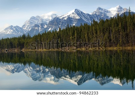 reflection of the mountains and forests in the Emerald lake in Sabwatcha canyon, Argentina