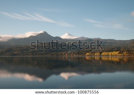 Reflection of the Volcano Villarica on the co���±aripe city lake (long exposure version)