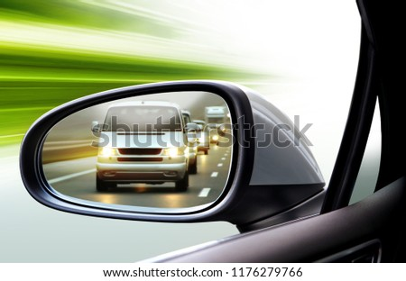 reflection of traffic flow in left side rear view mirror at twilight time #1176279766