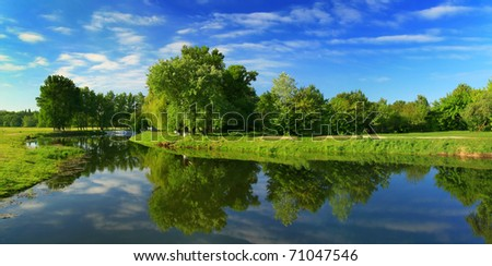 Reflection of trees in the river at dawn #71047546