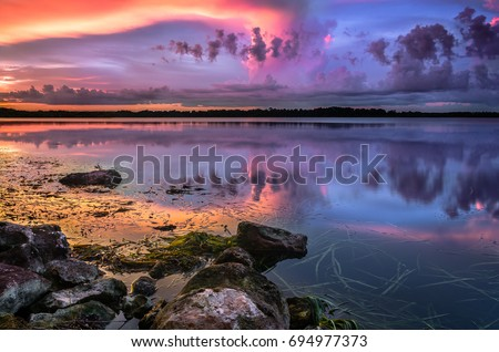 Reflection off Lake Baldwin in Winter Park, Florida during sunset.