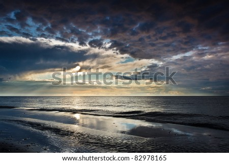 Reflection on the sand over dynamic sky