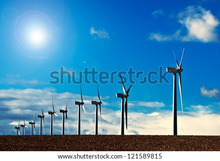 reflection on windmills and blue sky - stock photo