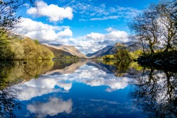 Reflections at Llyn Padarn with Dolbadarn Castle at Llanberis in Snowdonia National Park in background - Wales - United Kingdom