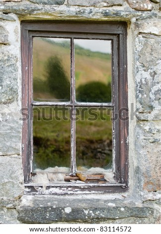 Reflections in an old scottish crofters cottage window