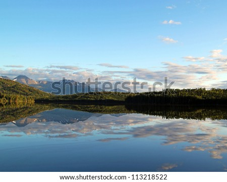 Reflections in Engineer Lake in the Kenai National Wildlife Refuge in Alaska in evening light.