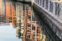 Reflections in the water of a canal in Venice