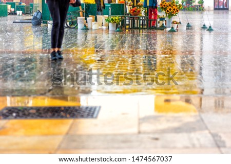 Reflections in the wet stone floor.Old city in the rain. View of the main square in Krakow. Rainy weather. Empty market place. Walking tourist. Bored tourist with umbrella.  #1474567037