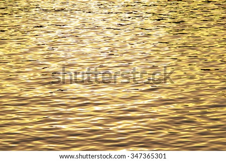 Reflections of a beautiful sunset on the water autumn