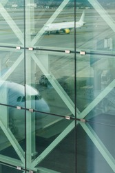 Reflections of aircraft in tinted glass, Barcelona airport, Spain