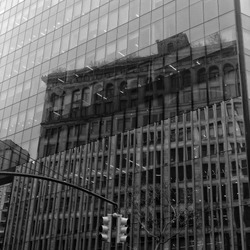 Reflections of an old building on a new building. IBM building in Astor place nyc.