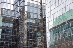 Reflections of building in a nearby glass facade building