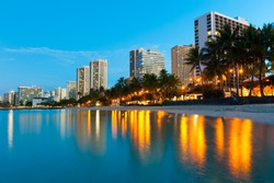 Reflections of buildings at Waikiki in the water.