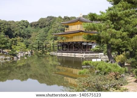 Reflections of the zen buddhist Temple of the Golden Pavilion (kinkaku-ji), Kyoto, Japan.