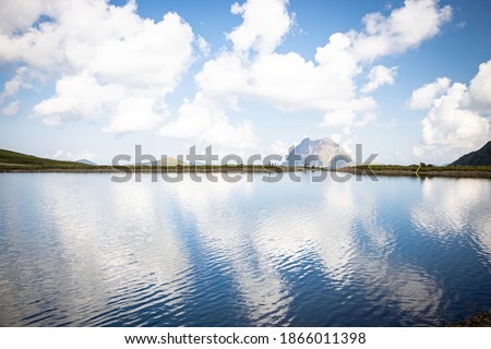 Photo of  Reflective Lake with Clouds Alps