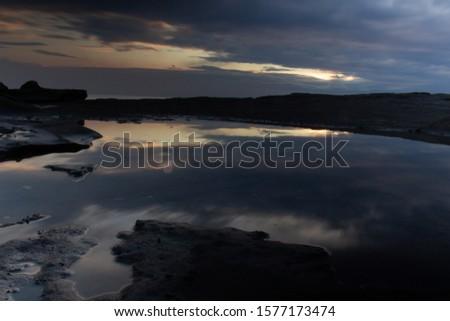 Reflective sunrise Sunrise in a reflection