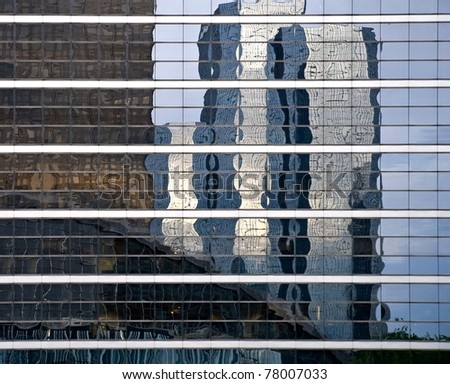 Reflexion of modern builds in windows of office building