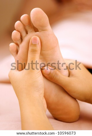 reflexology foot massage spa foot treatment.