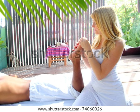 reflexology massage therapy physiotherapy in jungle cabin digital pressure [Photo Illustration]