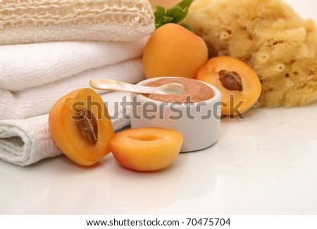 refreshing apricot spa treatment equipped with apricot scrub and other exfoliants. - stock photo