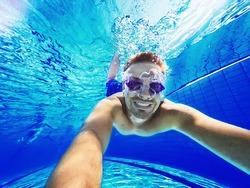 Refreshing at pool. Underwater wide angle selfie shot.