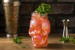 Refreshing Boozy Zombie Tiki Cocktail with MInt in a Skull Glass