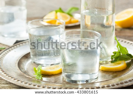 Refreshing Clear Sparkling Water with Lemon and Mint #433801615