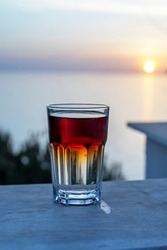 refreshing drink on the counter at sunset, lockdown