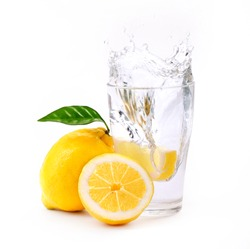 refreshing glass of water with splashed lemon isolated on white