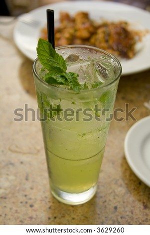refreshing ice cold mojito on a table