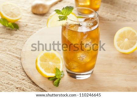Refreshing Iced Tea with Lemon against a background