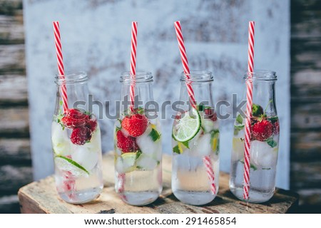 Refreshing infused water summer drinks with strawberries and lime