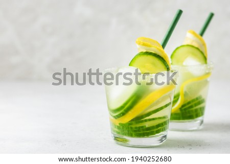 Refreshing lemon cucumber summer iced drinks. Space for text.