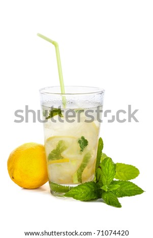 Refreshing lemonade with lemon and mint isolated on white background