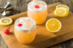 Refreshing Raki Vodka Sour Cocktail with a Cherry