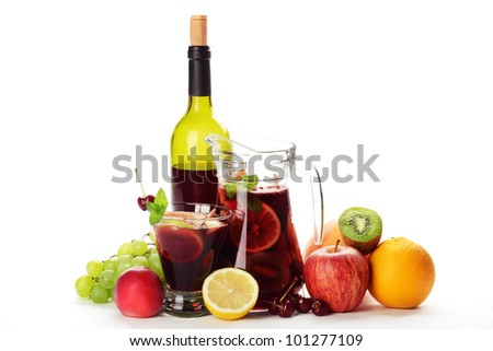 Refreshing sangria (punch) with fruits on white background