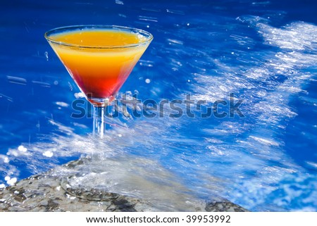 Refreshing sex on the Beach cocktail with big water splash